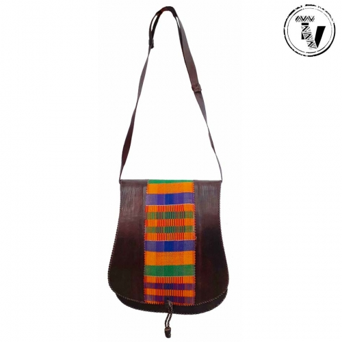 Our founder, Sian, recently travelled to Ghana in West Africa. During her time there she visited several talented artisans including the kente weavers in the Ashanti Region. Kente cloth originates from West Africa whereas African print fabric (commonly known as 'ankara' in West Africa and 'kitenge' in East Africa) was first produced in Indonesia. HISTORY OF KENTE Kente is no ordinary cloth and is easily recognisable worldwide. The method of producing kente, called strip weaving, has existed in West Africa since the 11th century. In 1697, the King of the Ashanti Kingdom, Osei Tutu, selected several weavers from nearby towns and villages to travel to neighbouring Ivory Coast to become experts in the complex art form. Otumfuo Osei Tutu II King Ashanti Kingdom wearing kente in Ghana Otumfuo Osei Tutu II, the current King of the Ashanti Kingdom wearing kente Once they returned to Ghana, they started to weave the beautiful and colourful cloth exclusively for the King because kente was originally made and worn only by the royals. The weavers started to create their own unique designs, which are now well known worldwide as 'Ashanti kente'. The Ewe is another ethnic group who also weave kente in Ghana. Today, the Ashanti royals still wear the sacred cloth usually draped across the shoulders, including traditional black and white designs, for prestigious occasions including: ceremonies, worship, outings, marriages and funerals. A weaver in Ghana West Africa using a handloom to create a traditional black and white kente cloth design A weaver creating a traditional black and white kente design on a handloom in Ghana MODERN AFRICAN PRINT CLOTHING Today, the cloth can be purchased and worn by local people and kente outfits are very popular to wear at weddings and special occasions. Akans, from the Ashanti kingdom, traditionally wear clothes made from kente cloth. It is a source of pride for many Ghanaians and the Diaspora. Original kente is a status symbol of wealth and identity as it is a luxurious and expensive fabric. Every new kente design is registered and copyrighted for protection. However, ankara fabric manufacturers in Ghana and China, for example, are replicating the kente designs. African wax print fabric is cheaper and more affordable than original kente cloth as they are printed by machine. This is likely to have contributed to the worldwide popularity of 'kente' as it is more readily available. It has also encouraged young, aspiring fashion designers to experiment with the printed fabric by making modern African print clothing. As well as Ghanaian clothing fashion, kente is also used to make homewear such as blankets, pillowcases and place mats. Raw Materials & Preparation The type of raw materials used for weaving include: Cotton (grown in the north of Ghana) Silk (very expensive and was the traditional thread used) Rayon (synthetic fibre) Metallic thread (adds shine to cloth) Usually, the threads are hand spun by villagers where the kente is made as it is cheaper than buying a ready spun cone. The traditional hand spinning method is demonstrated in this short video clip. The dye used to change the thread colour can be made locally by grinding the bark or leaves of trees. Local dyes are preferred as the colours do not fade but most dyes are imported from China or Japan. Coloured threads and shuttles used for kente weaving in Ghana West Africa Different coloured threads and two shuttles used for weaving METHOD OF WEAVING KENTE Kente cloth is purely hand woven; no machinery is used. Weavers sit inside a wooden handloom to create long, narrow interwoven strips that are later sewn together by a tailor to make the traditional kente cloths. It can take a long time to set-up a new design on a handloom, which requires a lot of experience. Weavers use both their hands and feet to operate the loom. The warp is placed quite far away from the loom under heavy stones to keep it taut, which gradually moves closer to the loom the more cloth that is produced. Warp thread placed under heavy stones during kente weaving production using a handloom in Ghana West Africa The warp placed under heavy stones in front of the handloom A kente weaver in Ghana West Africa controlling a handloom using their feet A weaver using their feet to control the handloom The heddles (cords), separate the warp threads so the weft can be passed or thrown through using a shuttle. The warp is then beaten in evenly using the 'beater' to make it more compact. A kente weaver in Ghana West Africa using a shuttle to pass the weft thread through warp using a handloom A weaver using a shuttle to pass the weft through the warp The more complicated the design the more expensive it is to purchase. There are 3 kinds of weaving known locally in this village as simple, double and triple. The latter being the most complicated as the designs can take 4-5 hours for an experienced weaver to make just one strip! Or if you prefer you can draw your own design and they can replicate it for you. When President Obama visited they made a special design for him in his honor. If a local person does a good deed in their community they can also name a new design after them. Traditional kente cloth handwoven in Ghana West Africa